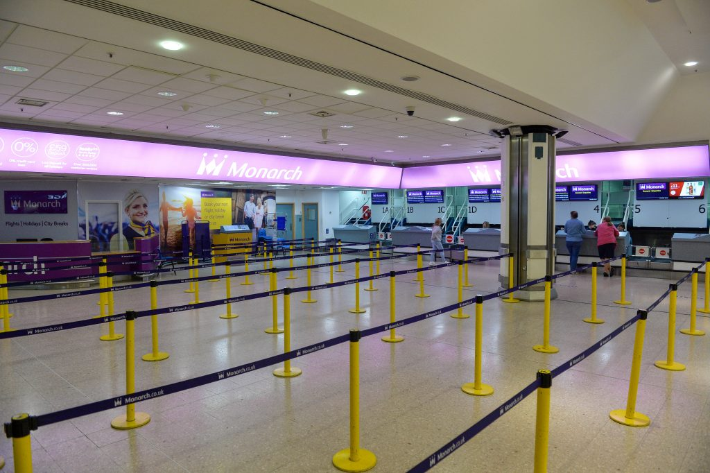 The empty desk's at Birmingham Airport where hundreds of holiday makers have been left stranded after Monarch Airlines collapsed overnight.