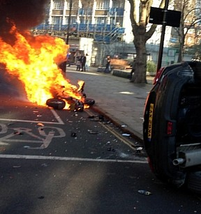 The moped bursts into flames after a collision with a car in Islington, north London