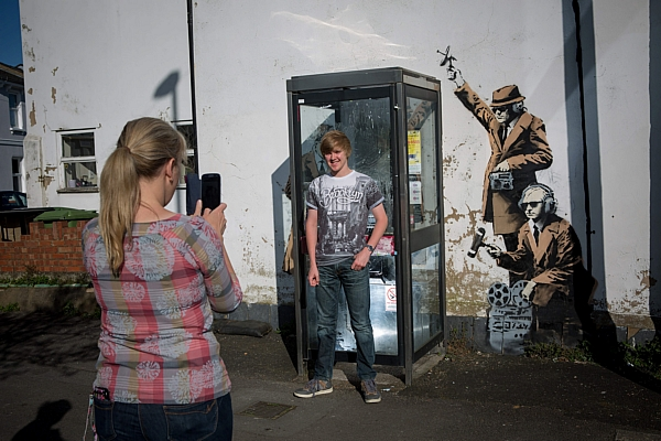 Crowds of people flocked to the Banksy mural which appeared in Cheltenham close to spy centre GCHQ