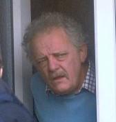 Nigel Phillips at the door of his home