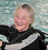 Pat Fung climbs out of the pool with her scuba gear as she's on course to become the UK's oldest female diver