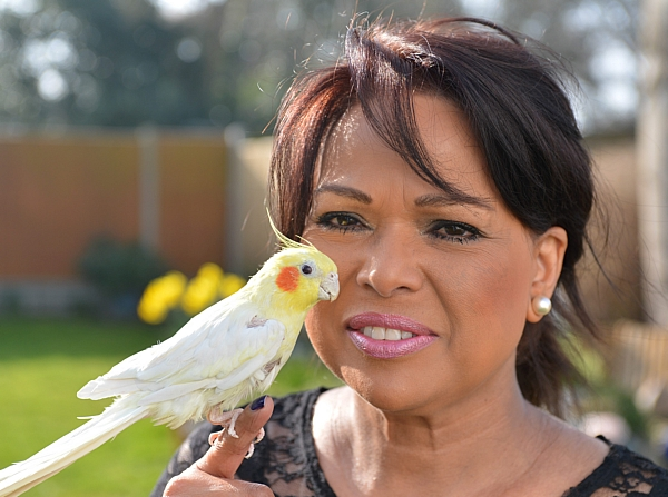 Farida Miah with her pet Pia the 30 year old cockatiel