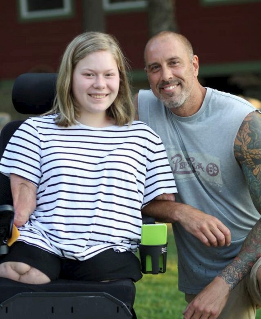 Bella Tucker who lost her limbs to meningitis, pictured here with her dad Rich.