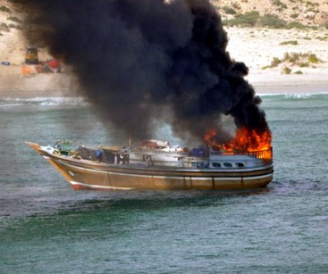 The pirate ship catches fire after losing the gun battle