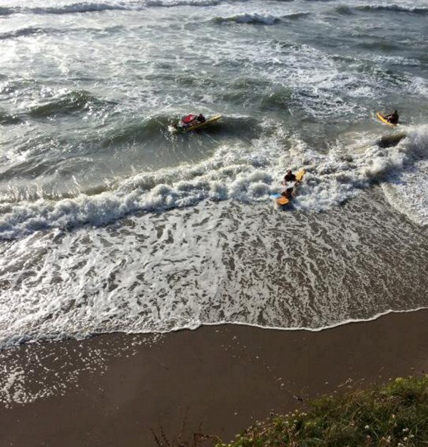 One of the RNLI rescues at Polzeath after 32 people got caught in rip tides