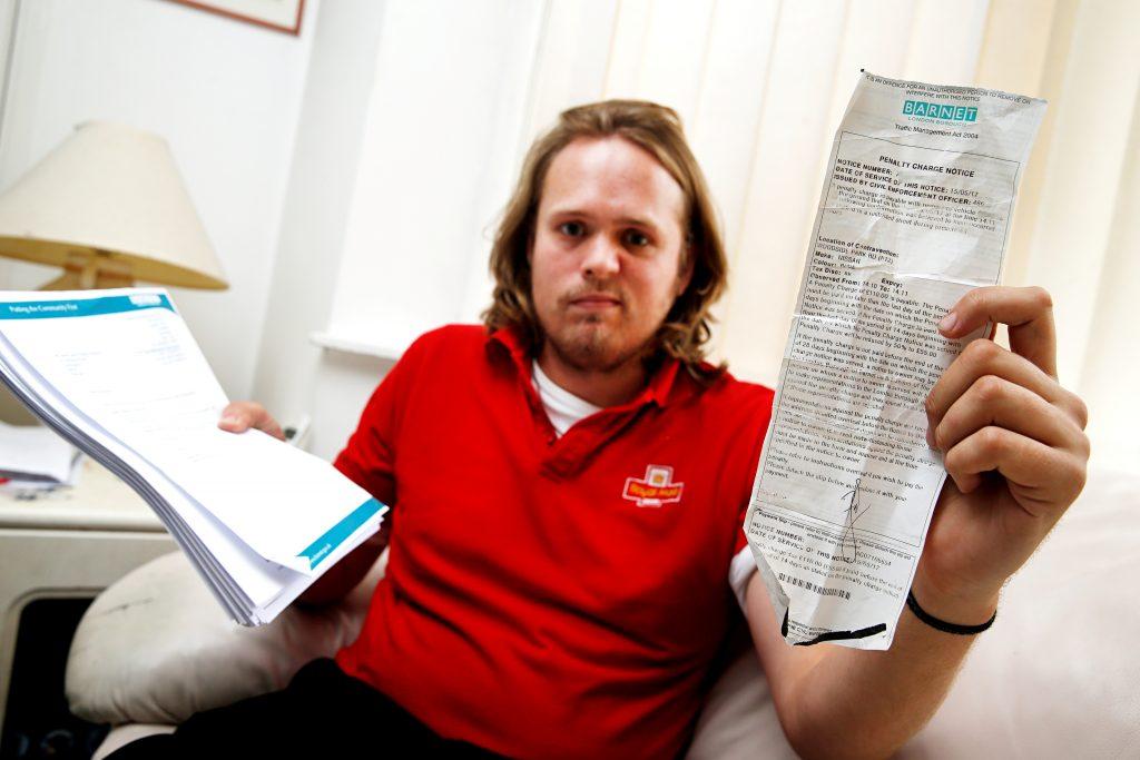 Postman David Welland with his parking ticket.