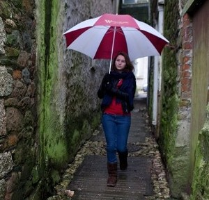 Isobel Crarer, 18, walks down Wheelbarrow Lane in Helston, where postmen have refused to go in case they slip on pigeon poo