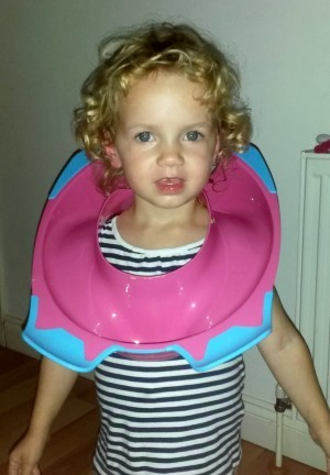 Teagan Culverhouse with the toilet seat stuck around her head