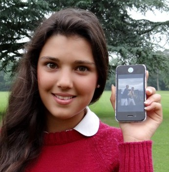 Andrea Rubio, 14, who because famous for a day when she was snapped photographing Princes William and Harry shows off the picture on her phone