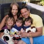 Emma Day, 27, and her husband cuddle their children after she is given the all clear following radiation treatment for cancer