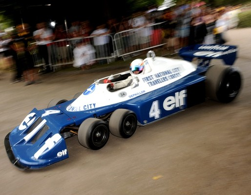 The unconventional 1976 Tyrrell P34, which has six wheels, in action