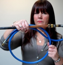 Health and Safety Officer Tricia McLeish holds a home-made industrial blow-torch found being used to cook chapatis at a curry houses in Glasgow