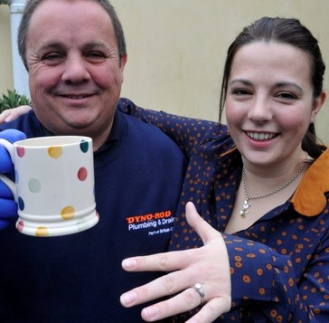 Plumber Dave Scanes and Sian Robbins, wearing the ring he sifted through 100 gallons of sewage to find