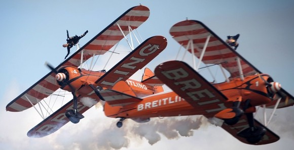 The Breitling Wingwalkers team performs at the Royal International Air Tattoo at RAF Fairford in Gloucestershire