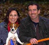 Paul holds his safe stick with wife Helen Blair and dogs Roxy and Razzle. He was laughed off Dragons' Den but has now sold the product around the world