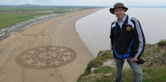 Julian Richardson has unveiled his latest masterpiece - a '€˜sand circle'€™ measuring a staggering 80 METRES across