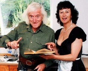 Sir Jimmy Savile and a waitress on the day that the Prince of Wales visited him at his cottage in Glencoe in July 1999