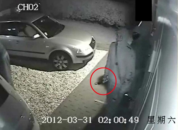 A gang of thieves with one man holding a blank key are caught on CCTV as they approach a BMW to steal it
