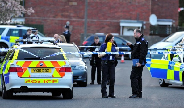 Police at the scene of the shooting after a wheelchair-bound man pulled out a shotgun