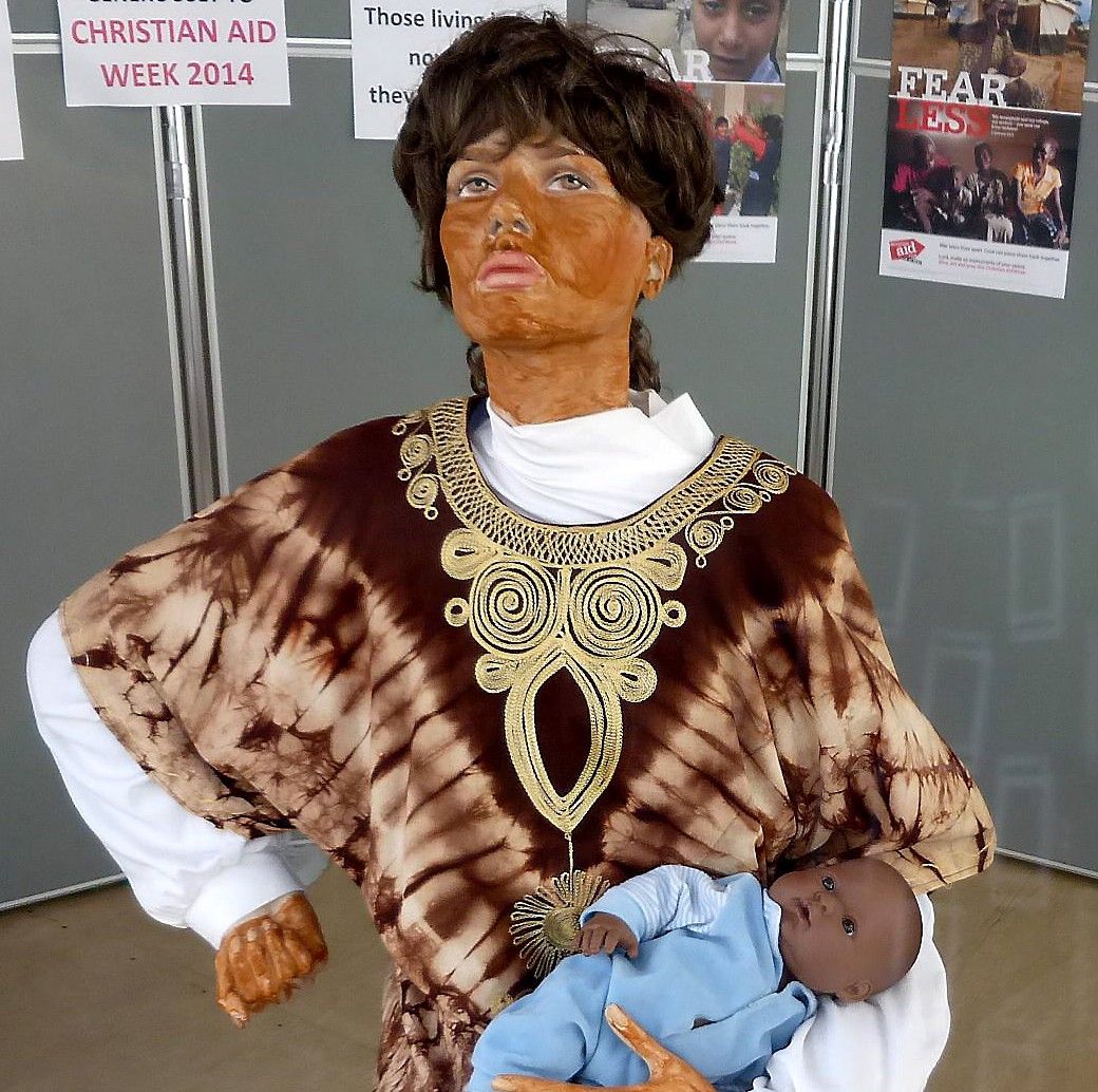 A church was ridiculed over this display promoting Christian Aid week - using a 'blacked up' mannequin