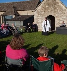 People gather for the annual service at Britain's tiniest church, in the glorious bank holiday sunshine