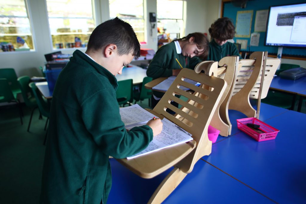 Oscar, Piper and Harvey are seen using the stand up desks at Kewstoke Primary School.
