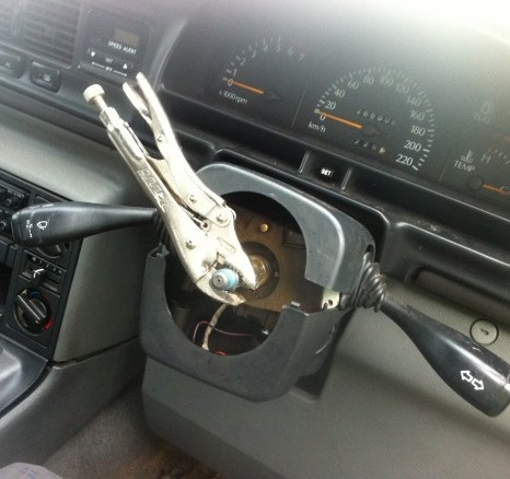The set of pliers attached to the steering column that the driver was using in his car