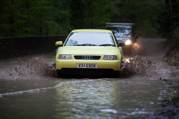 Cars battle through floods just outside Bristol. Dealers are being warned to look out for motors damaged by floods