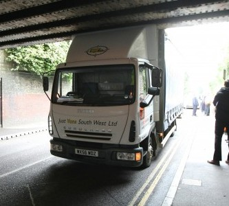 A trucker gets stuck under a railway bridge in Wiltshire just three days into his new job