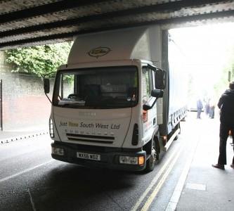 A trucker gets stuck under a railway bridge in Wiltshire just three days into his new job
