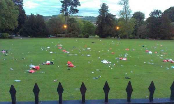 The lawn area in front of the Royal Crescent in Bath , Somerset covered in rubbish after a student party
