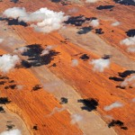 The November shadows of cumulus clouds dapple the parallel dunes of the Simpson Desert by Steve Strike