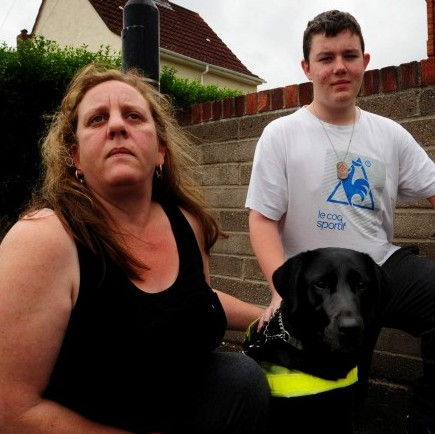 Clare Matthews with her son Peter Matthews and her guide dog Keisha. She was allegedly kicked out of a Subway restaurant for going in there with her guide dog