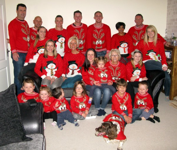 Doreen's whole family with their knitted jumpers