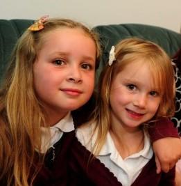 Kerry Ball with her daughters Stacey Jones, seven and Tiegan Jones, four