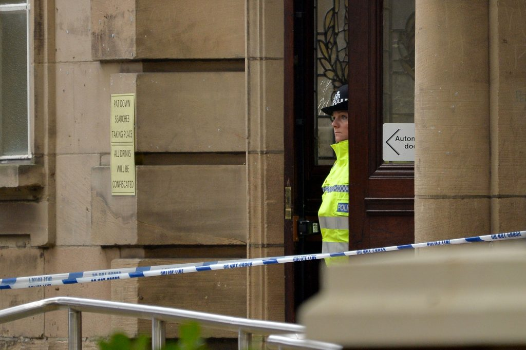 The scene at the Town Hall in Walsall town centre where police are investigating after a teenager was allegedly stabbed following a mass brawl at a Walsall boxing show last night.