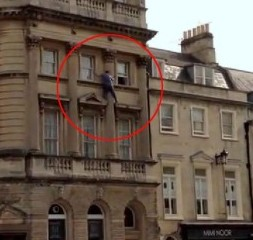 This daredevil window cleaner has been fined ££2,000 after he balanced on a third-floor ledge without a safety harness