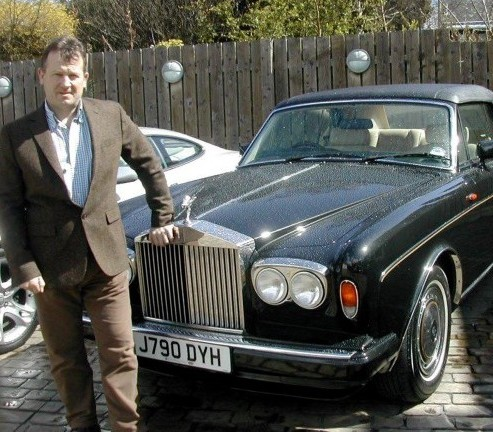 This stunning Rolls-Royce, pictured with dealer Derek Mowat, which belonged to the late Sir Michael Winner and has now been put up for sale on AutoTrader