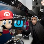Excited Izzy Rahman was served by Mario as he became the first to  buy a Wii U