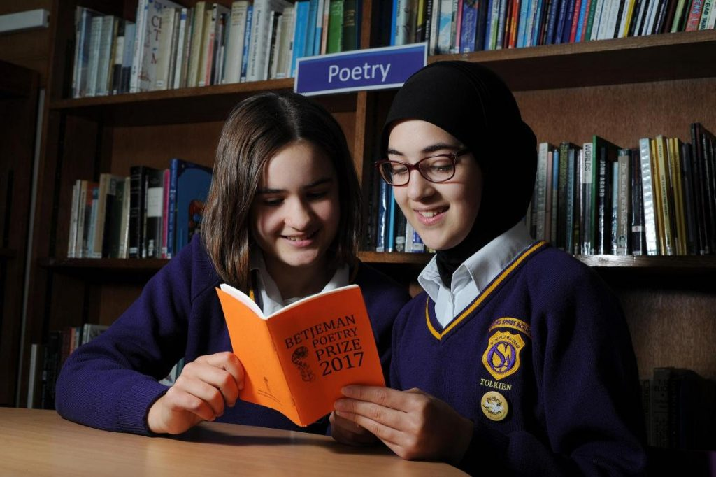 Oxford Spires Academy students Jemima Webster, left, aged 12, and Amineh Abou Kerech, 13, were both finalists in the John Betjaman Poetry Prize competition