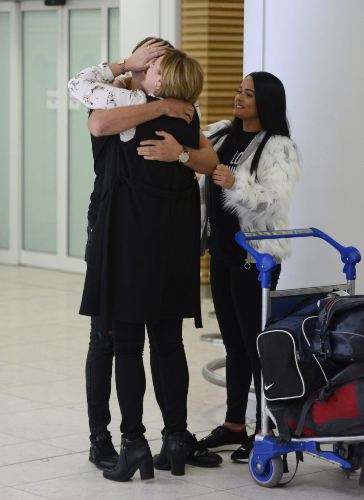 Jamie Harron, 27, from Stirling, greeted by his mother Patricia and sister Jordan as he arrives back in Scotland at Glasgow airport after being released from jail in Dubai.
