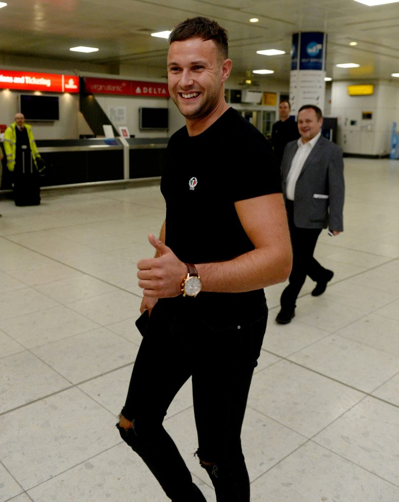 Jamie Harron arrives back in Scotland at Glasgow airport after being released from jail in Dubai.