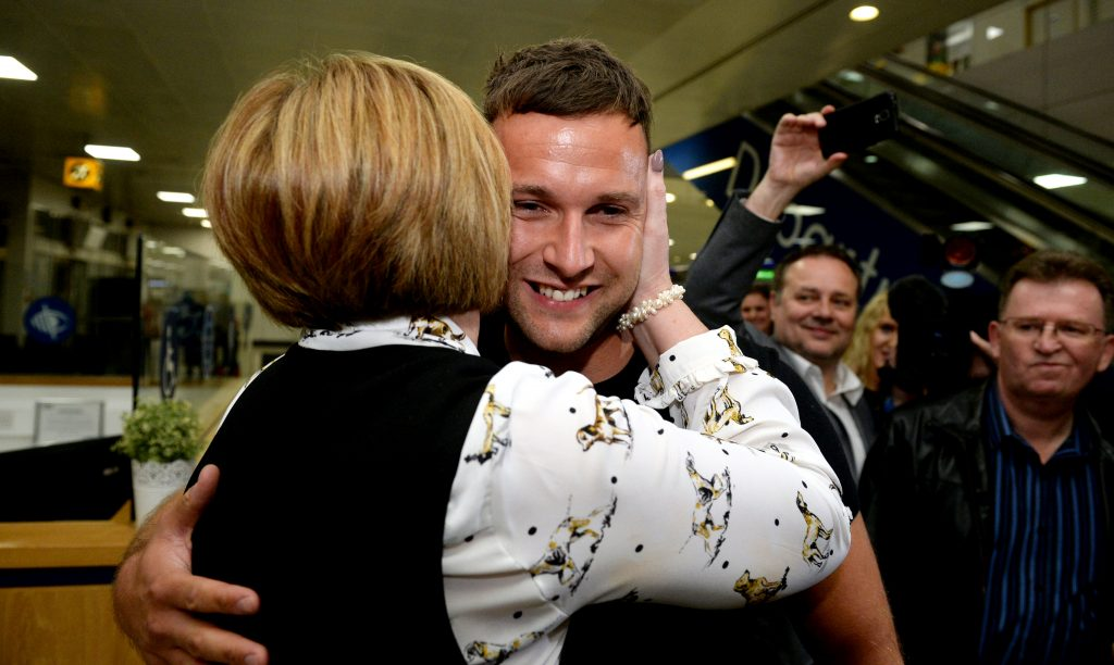 Jamie Harron with his mother Patricia as he arrives back in Scotland at Glasgow airport after being released from jail in Dubai.