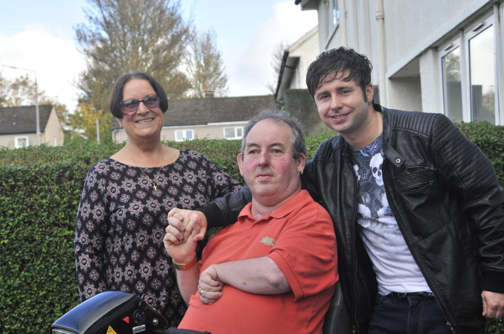 Hero Christopher McCluskey(R) is reunited Allan Meehan who he saved after falling into a canal in Clydebank