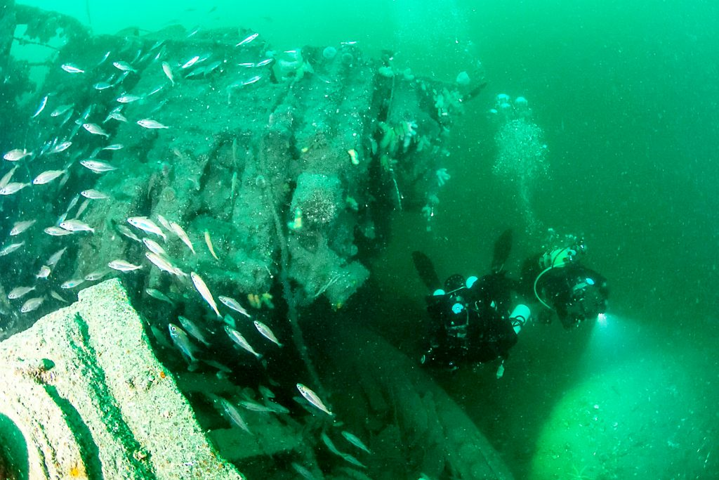 Underwater shots of Pat Fung diving at Scapa Flow on her 80th birthday.