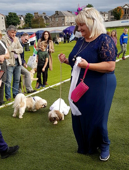 Ann McNeilage and her dog Diva walking down the aisle in Greenock, Inverclyde. A Shih Tzu and a Lhasa Apso who appeared on Judge Rinder have finally married in a ceremony led by a pug dressed as a vicar -- but not everything got off without a hitch.