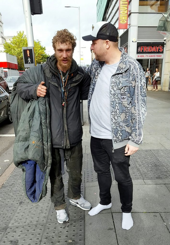 This is the heartwarming moment a homeless man broke down in tears when a Good Samaritan gave him his £120 trainers after seeing him walking barefoot in the street.