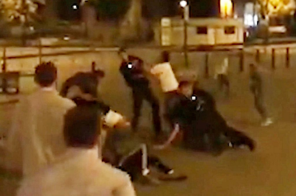 This is the shocking moment a police officer is punched to the ground during a mass brawl