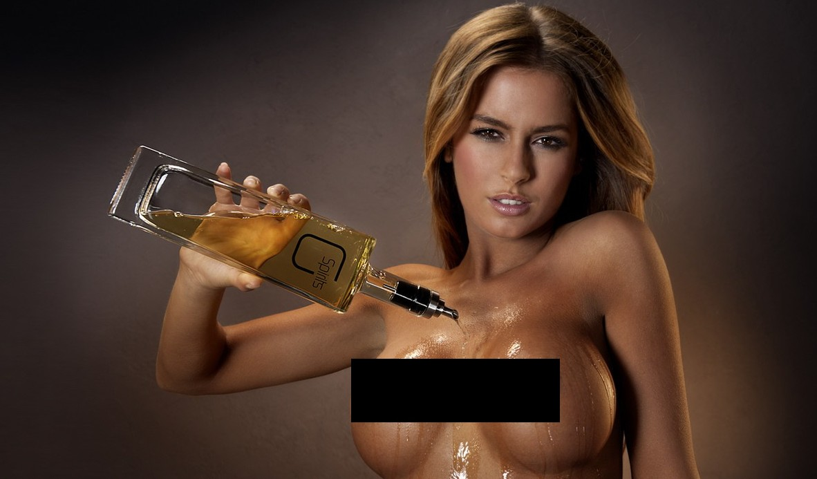 Hungary's current Playboy Playmate of the Year Alexa Varga splashes whisky across her chest