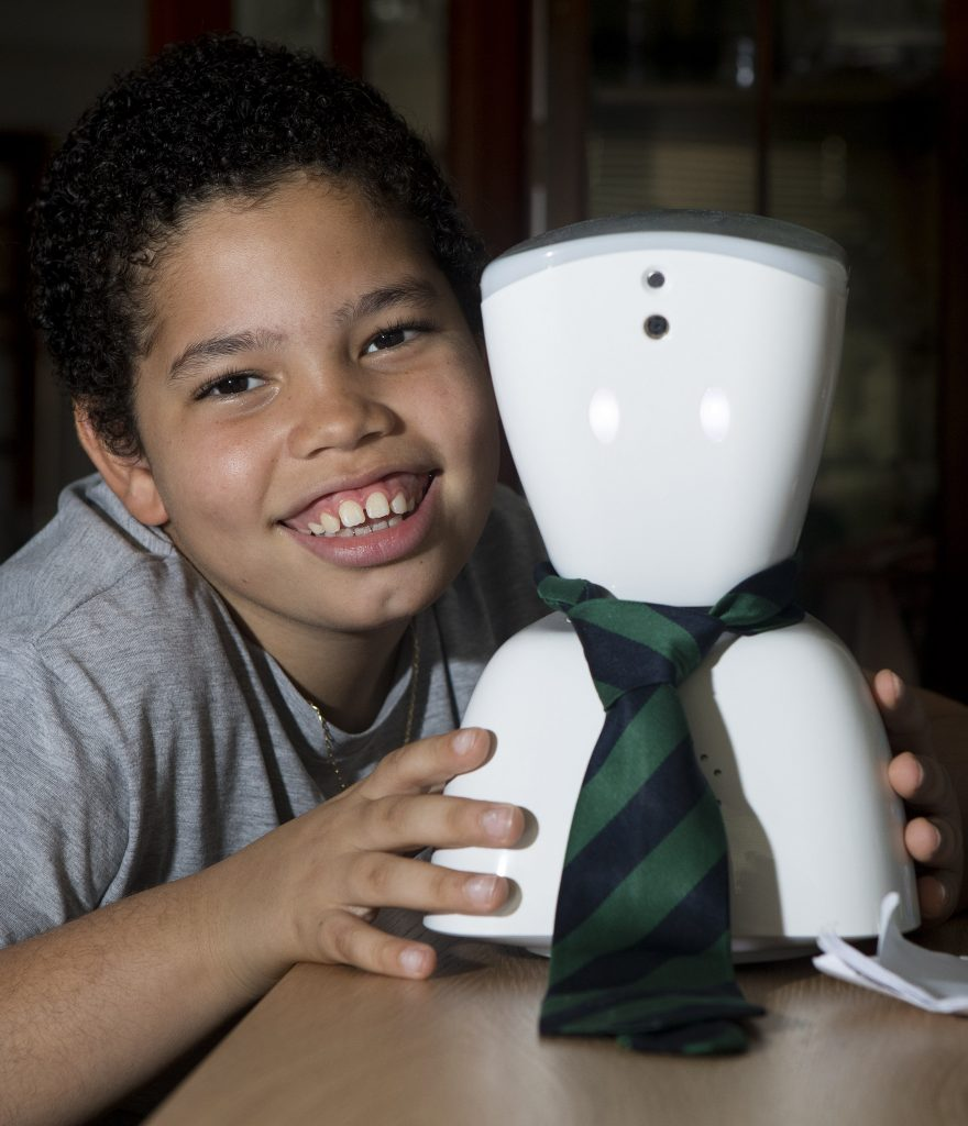 """Ten-year-old Keir Wallace, from Edinburgh who suffers from a rare disease and is often unable to attend school will send a robot to classes instead. Keir hopes he will be able to observe lessons via a """"telepresence"""" robot called AV1 while he is sitting at home. See Centre Press story story CPROBOT; A ten-year-old boy who suffers from a rare condition which limits his time in school hopes to send a robot to lessons in his place. Keir Wallace is one of only two people in the UK and just 27 people in the world who have been diagnosed with the incurable auto-immune disease FCAS2. It causes severe pain in his joints and can unexpectedly leave him in agony and unable to walk.  Last year, he wasn't able to attend a quarter of his classes at St John's RC School in the Portobello, Edinburgh, due to health concerns. But the youngster hopes a new robot, called the AV1, will help prevent him from missing out on his education."""